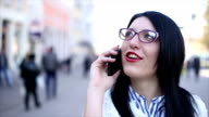 girl talking by phone on the street video