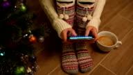 Girl texting for christmas video