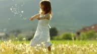 SUPER SLO-MO Girl Throwing Dandelion Seeds video