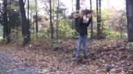 Girl throwing leaves video