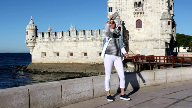Girl tourist taking a selfie photo video