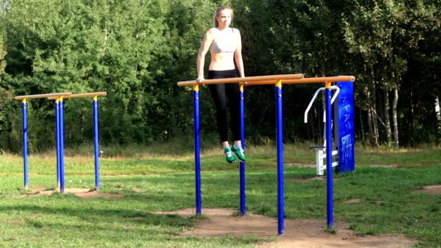Girl training on parallel bars. video