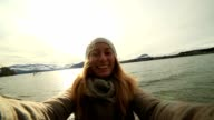 Girl traveling takes selfie with spectacular NZ landscape video
