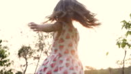 Girl Twirling at Park In Sunset video