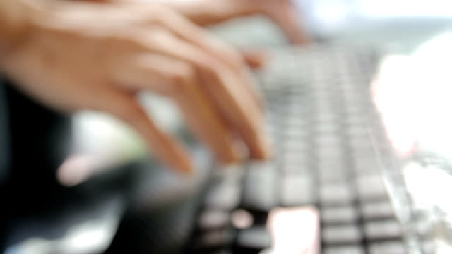 Girl Typing at Keyboard,motion focus concept video