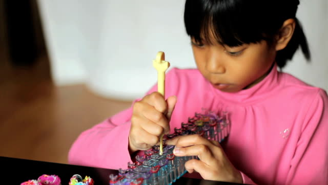 Girl Uses Hook On Her Bracelet Loom video