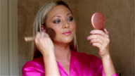 Girl Using A Blusher Brush video