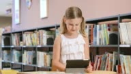 DS Girl using a tablet in the library video