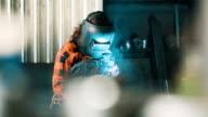 Girl using a welding machine video
