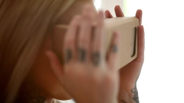 Girl Using Cardboard Virtual Reality video