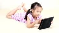 Girl using Digital tablet. video