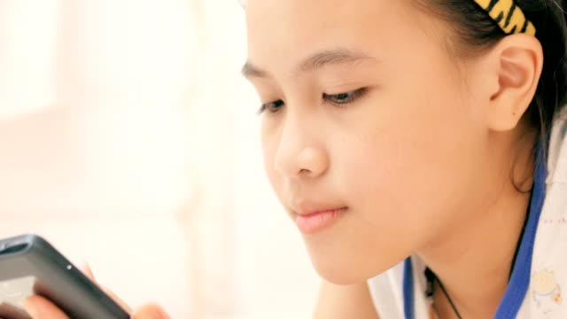 Girl using smart phone in bedroom video