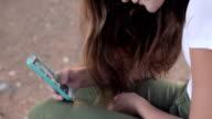 Girl using smart phone video