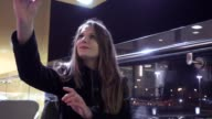 Girl using smartphone at the coffee shop video