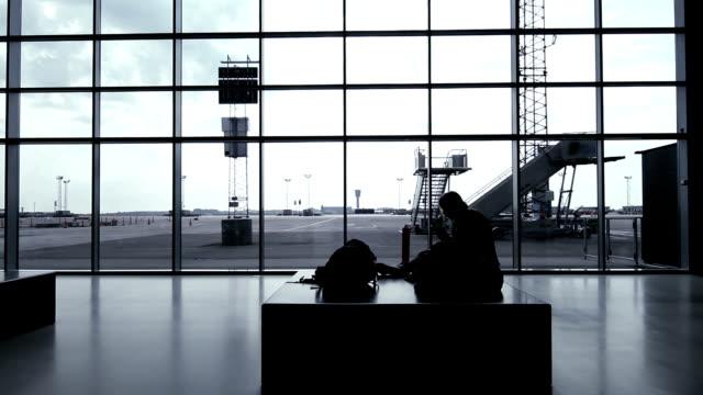 Girl waiting at airport terminal video