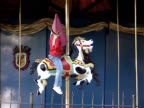 Girl Waiting for Parent on Carrousel Horse At Festival video