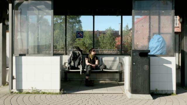 Girl waits the train on railwaystation video