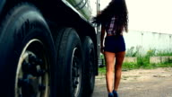 Girl walk near truck cistern and come upstairs of tank video