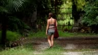 Girl walking alone on a path video
