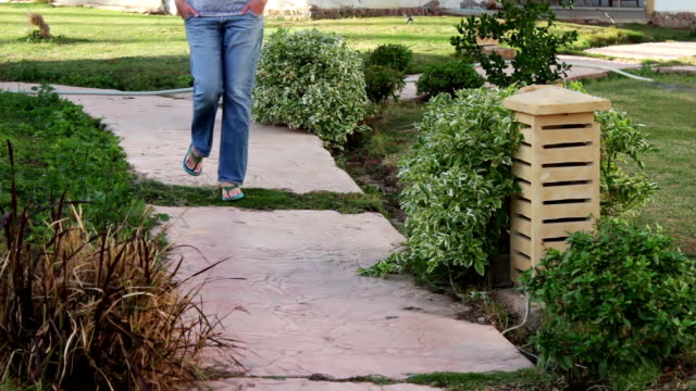 girl walking along a footpath video