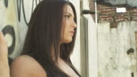 HD DOLLY: Girl walking along graffiti wall video