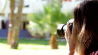girl walking in the park and take pictures video