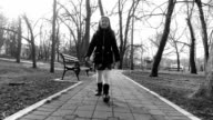 Girl walking in the park. Black and white video