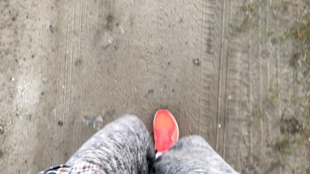 girl walks in pink sneakers on Earth video