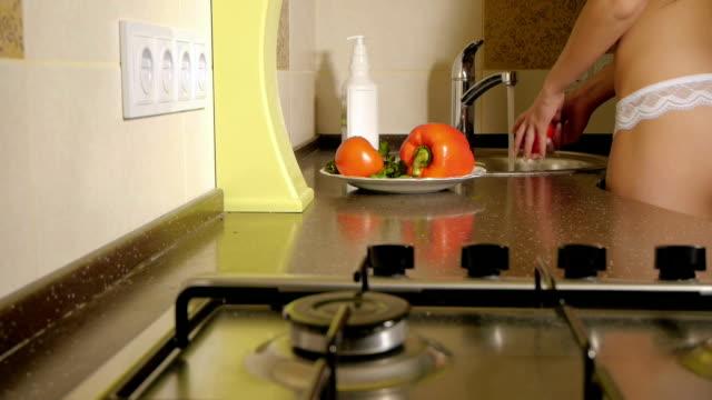 Girl washes vegetables erotic dancing video