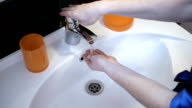 girl washing her hands in the sink video