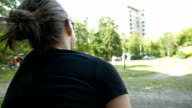 Girl watching kids play in the park video