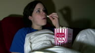 Girl Watching TV Eating Popcorn video