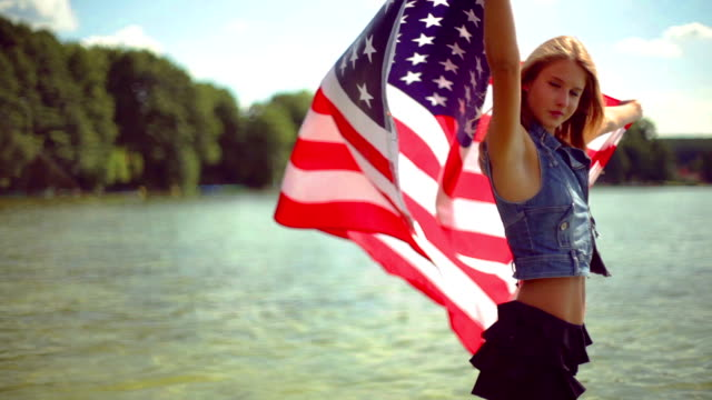 Girl waving the american flag. video