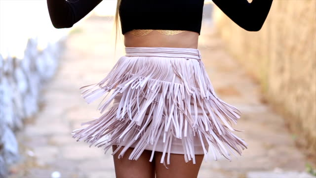 Girl wiggles her skirt with fringes video
