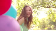 Girl with a bunch of balloons on a summer's day video