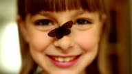 Girl with a butterfly on a nose video