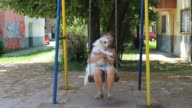 Girl with a dog on a swing video