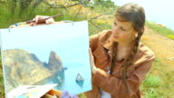 Girl with a picture of the beautiful coast video