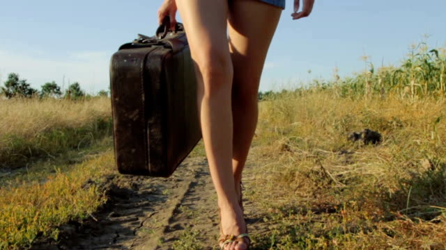 Girl with a suitcase on the road video