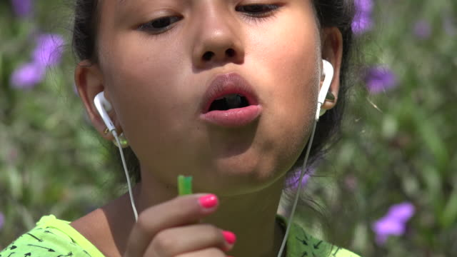 Girl With Braces Eating Candy video