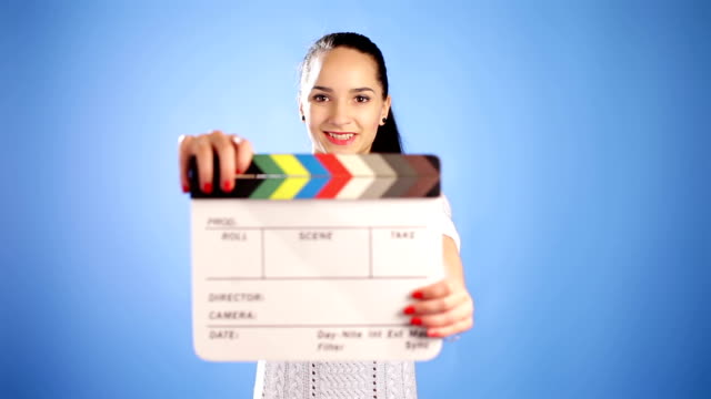 Girl with clapper board video