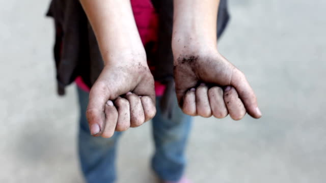 Girl with Dirty Hands showing to camera video