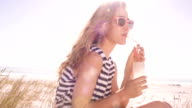 girl with lemonade at the beach on sunny summer day video