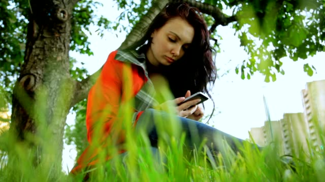 Girl with Phone in Hands in the Park video