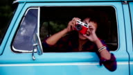 Girl with retro camera in old car video