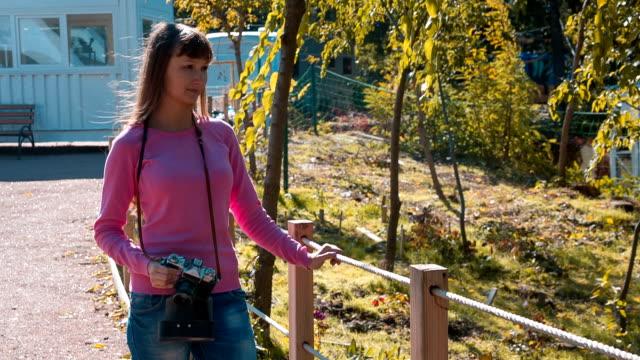 Girl with retro camera in trailer park video