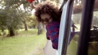 Girl with scarf in car slow motion video