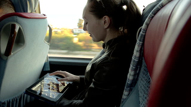 Girl With the Tablet in the Turist Bus video
