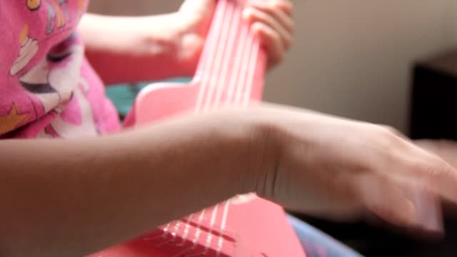 Girl With Toy Guitar video