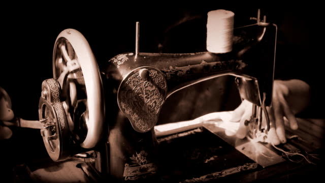 Girl working at an antique sewing machine video